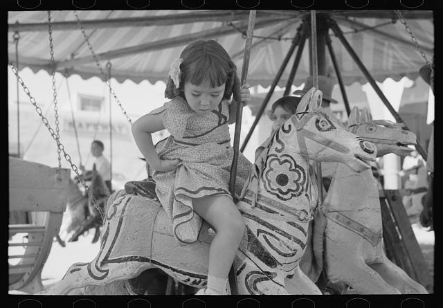 Little Girl on Merry Go Round at Taos Fiestas