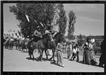 Two men riding horseback in a parade at Taos Fiestas 1940