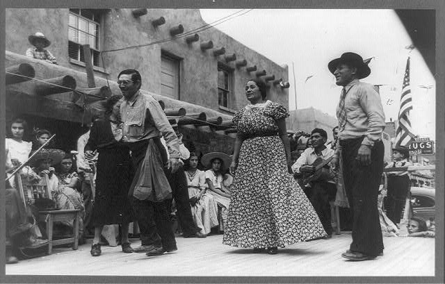 Two men and a woman dancing in the streets 1940